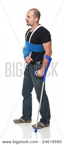 young man with crutch isolated on white