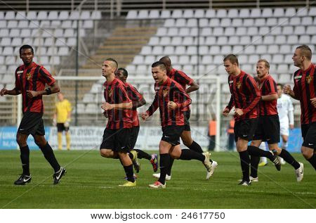KAPOSVAR, HUNGARY - OCTOBER 15: Honved players celebrate a goal at a Hungarian National Championship soccer game - Kaposvar (white) vs Honved (red) on October 15, 2011 in Kaposvar, Hungary.