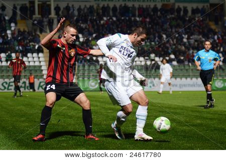 KAPOSVAR, HUNGARY - OCTOBER 15: Boris Gujic (in white) in action a Hungarian National Championship soccer game - Kaposvar (white) vs Honved (red) on October 15, 2011 in Kaposvar, Hungary.