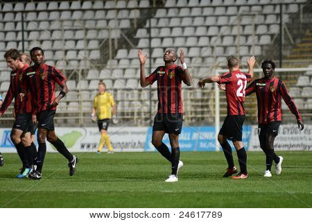 KAPOSVAR, HUNGARY - OCTOBER 15: Honved players celebrate at a Hungarian National Championship soccer game - Kaposvar (white) vs Honved (red) on October 15, 2011 in Kaposvar, Hungary.