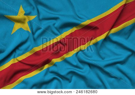 Democratic Republic Of The Congo Flag  Is Depicted On A Sports Cloth Fabric With Many Folds. Sport T