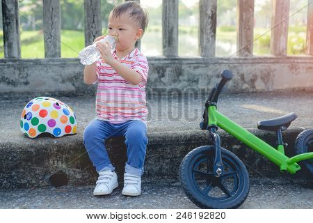 Cute Little Smart Asian 2 Years Old Toddler Boy Child Taking A Break And Drinking Pure Water From Pl