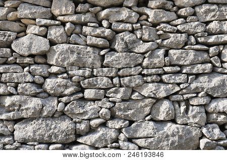 Part Of Old Dry Stone Wall Built Without Cement Or Grout In Southern France