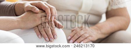 Person Supporting Weak Elderly Woman