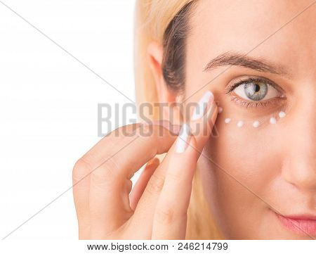 Eye Cream Treatment. Close Up Of Green Eye Beautiful Woman Applying Eye Cream. Anti-aging And Wrinkl
