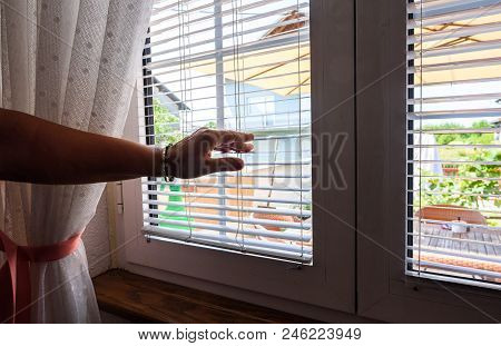 Woman Hand Open Jalousie On Pvc Window
