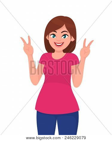 Beautiful Young Woman Showing/gesturing Victory Sign. Pretty Girl Showing Success Sign.