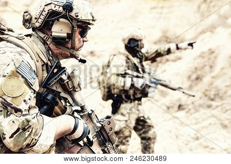Us Special Operations Forces Fighters Armed With Assault Rifle, In Opscore Helmet, Radio Tactical Op