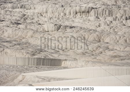 The Beautiful White Cascade In Pamukkale In City Of Denizli. The Beautiful Limestone Hill With The S