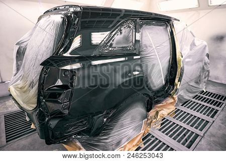 Painting The Car In Black Color In The Paint Chamber On The Service.