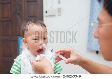 Asian Parent Flushing His Sick Cute Little Asian 18 Months / 1 Year Old Toddler Baby Boy Child Nose