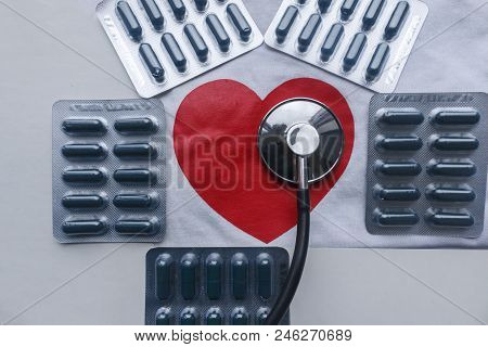 Five Blisters Of Pills Around A Red Heart With A Stethoscope. Pills In Blister Packs And Red Heart W
