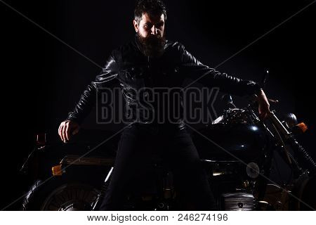 Macho, Brutal Biker In Leather Jacket Stand Near Motorcycle At Night Time, Copy Space. Man With Bear