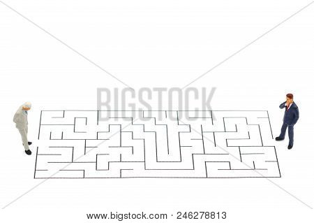 Miniature People: Businessman Standing On Start Point Of Maze And  Thinking How To Solve This Proble
