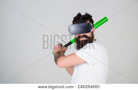 Bearded Gamer With Agitated Look Training Batting Skills, Simulation Game Concept. Man With Stylish