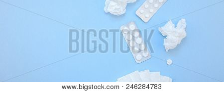 Creative Flat Lay Concept Of Seasonal Spring Allergy With Napkins, Pills, And Drops In A Bottle With
