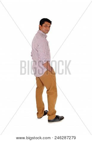 A Handsome Middle Age Man Standing In A Re Checkered Shirt With His Hands In Pocket, Looking At Came