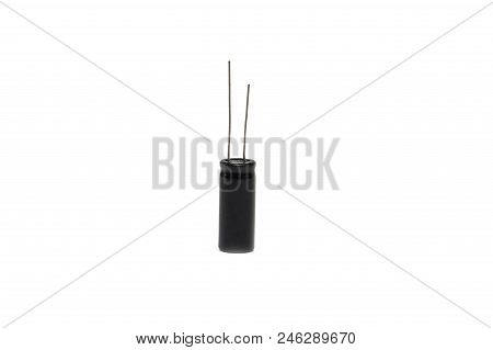 Black Electrolytic Capacitors On A White Background, Isolate, Electronic Object