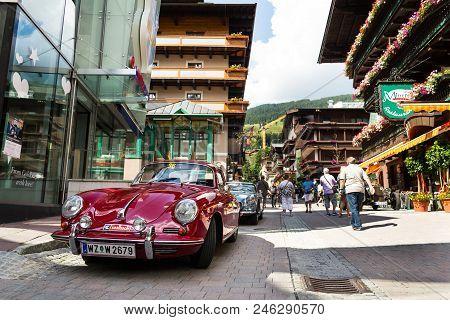 Saalbach-hinterglemm, Germany - June 21 2018: People Looking At Porsche 356 Oldsmobile Vintage Veter