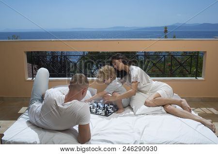Family Travel With Kid On Mothers Or Fathers Day. Mother And Father With Son On Balcony. Summer Vaca