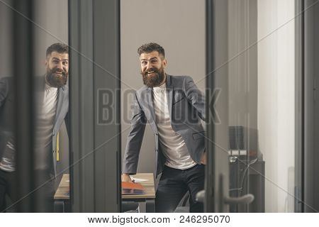 Happy Businessman In Modern Office With Glass Walls. Bearded Man Look Out Room Door. Confident Man I