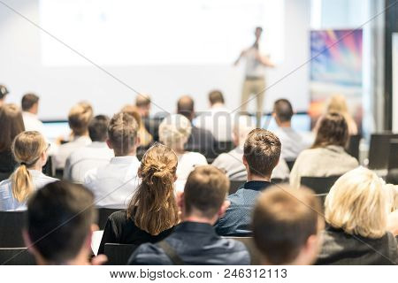 Speaker Giving A Talk In Conference Hall At Business Event. Audience At The Conference Hall. Busines