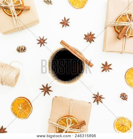 Christmas Or New Year Background With Paper Gift Boxes, Mug Of Coffee, Anise And Dried Orange Fruit