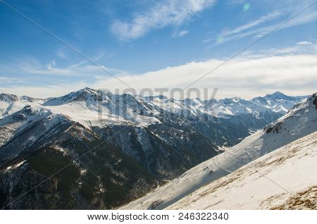 Snowy Caucasus Mountains, The Path To Adventure. Mountain Gorge, View From Above.