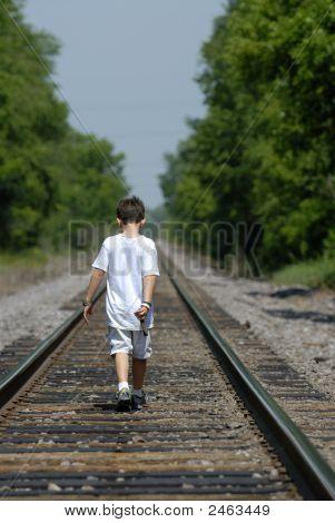 Boy On Railroad