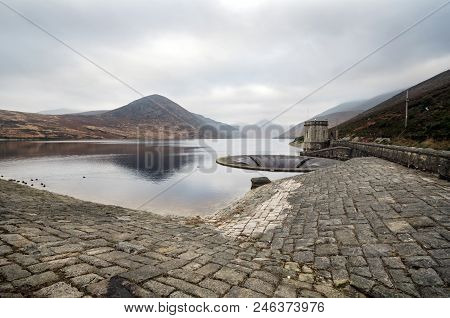 A view of the Silent Valley leading to misty mountains