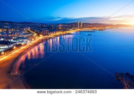 Aerial View Of Barcelona Beach In Summer Night Along Seaside In Barcelona, Spain. Mediterranean Sea
