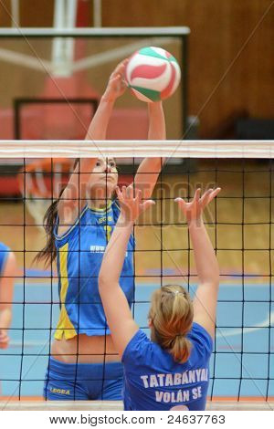 KAPOSVAR, HUNGARY - OCTOBER 2: Zsofia Harmath (L) in action at a Hungarian NB I. League volleyball game Kaposvar (yellow number) vs Tatabanya (white number), October 2, 2011 in Kaposvar, Hungary.