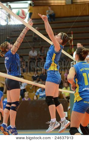 KAPOSVAR, HUNGARY - OCTOBER 2: Kamilla Gyorbiro (C) in action at a Hungarian NB I. League volleyball game Kaposvar (yellow number) vs Tatabanya (white number), October 2, 2011 in Kaposvar, Hungary.