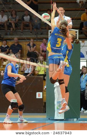 KAPOSVAR, HUNGARY - OCTOBER 2: Zsofia Harmath (3) in action at a Hungarian NB I. League volleyball game Kaposvar (yellow number) vs Tatabanya (white number), October 2, 2011 in Kaposvar, Hungary.