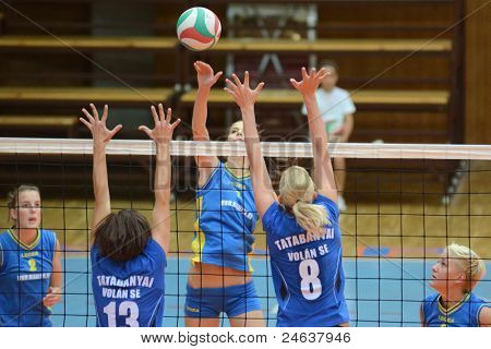 KAPOSVAR, HUNGARY - OCTOBER 2: Zsofia Harmath (C) in action at a Hungarian NB I. League volleyball game Kaposvar (yellow number) vs Tatabanya (white number), October 2, 2011 in Kaposvar, Hungary.