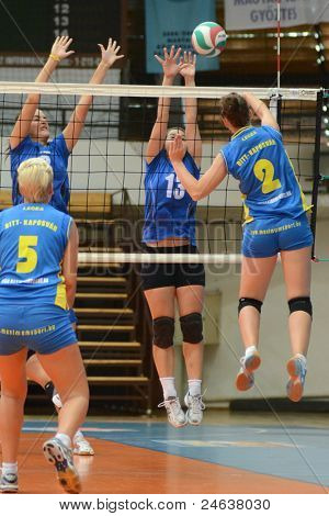 KAPOSVAR, HUNGARY - OCTOBER 2: Zsanett Pinter (2) in action at a Hungarian NB I. League volleyball game Kaposvar (yellow number) vs Tatabanya (white number), October 2, 2011 in Kaposvar, Hungary.