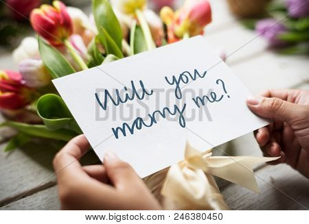 Flower bouquet with the phrase will you marry me
