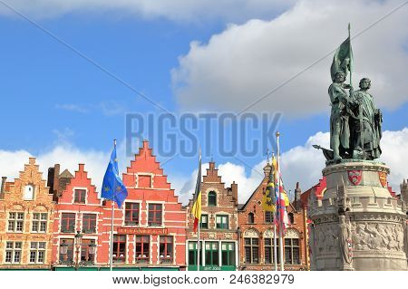 Bruges, Belgium - April 18, 2014: The Markt With Colorful Facades And Statues Of Jan Breydel And Pie