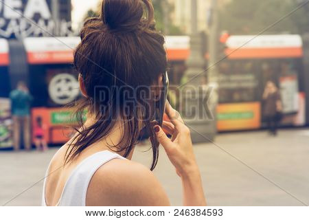 Girl Speaking On The Phone. Young Woman Speaking On The Cell Phone. Girl Speaking On The Cell Phone