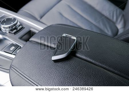 Closeup Inside Vehicle Of Wireless Key Ignition. Start Engine Key. Car Key Remote In Black Perforate
