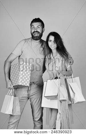 Shopping And Leisure Concept. Man With Beard Holds Polka Dotted Box. Couple In Love Holds Shopping B
