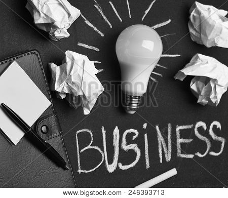 Business Success Concept. Board With Light Bulb, Yellow Chalk, Pen And Stickers. Process Of Creation