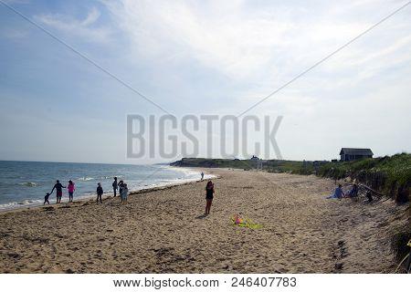 Montauk, New York-june 8: Beachgoers And Girl Seen Flying Kite On Ditch Plains Beach, Montauk, The H
