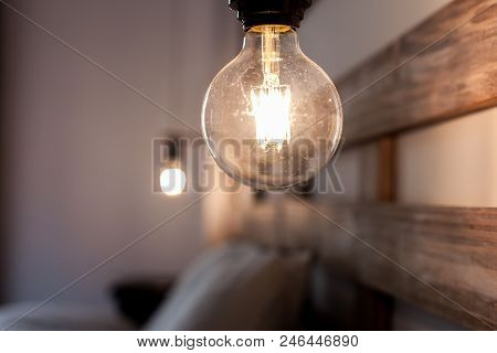 Bulb Next To The Bed In The Bedroom
