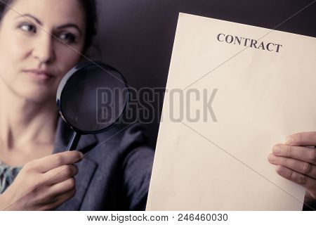 Contracts And Agreements Concept. Adult Beauty Woman In Jacket Holding Showing Contract. Close Up Po