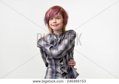 Portrait Of Unusual Informal Pretty Woman With Colorful Hairstyle Pretending Like She Is Hugging Her