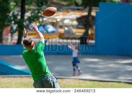 American Football Player Catching A Touchdown Pass In Park