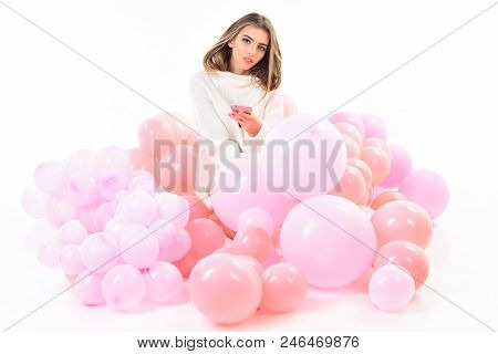 Balloon Party. Girl In White Sweater Sits In Balloons. Balloon. Trendy Young Woman Laying Between Pi
