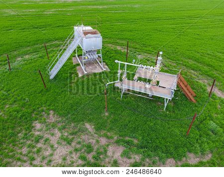 A Tank With Methanol Near The Oil Well. Equipment Of An Oil Well. Shutoff Valves And Service Equipme