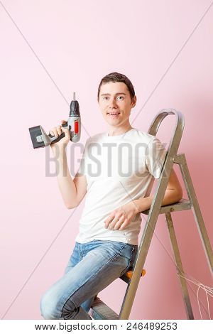 Image Of Man With Drill Near Ladders On Background Of Pink Wall